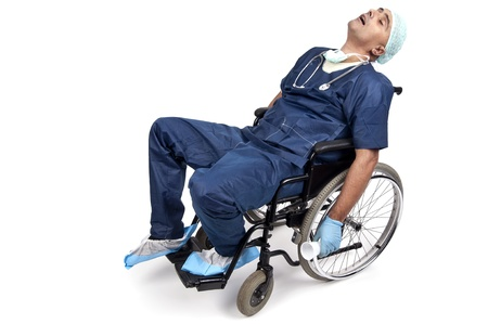 Tired doctor sleeping in a wheelchair photo