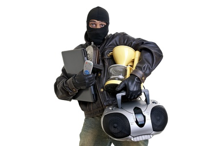 Burglar with goods isolated in white photo