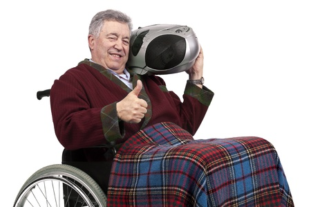 Lonely elderly in a wheelchair with big radio photo