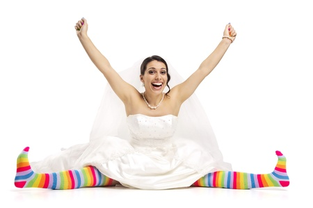 Happy bride posing with coloful stockings  photo