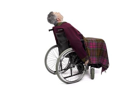 Lonely elderly in a wheelchair photo