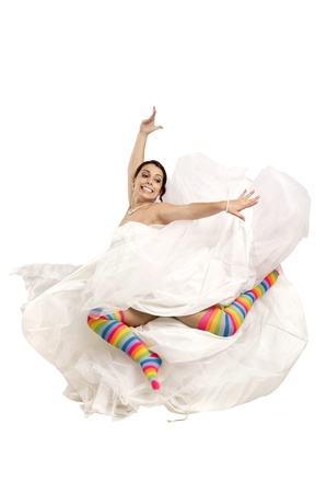 Happy bride jumping with colorful stockings  photo