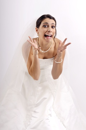 Stressed bride posing isolated in white Stock Photo - 14406217