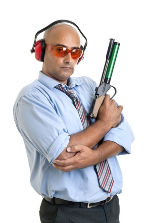 Businessman with compressed air gun  photo