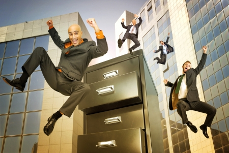 happy businessman jumping from binder in a business center Stock Photo - 14778945