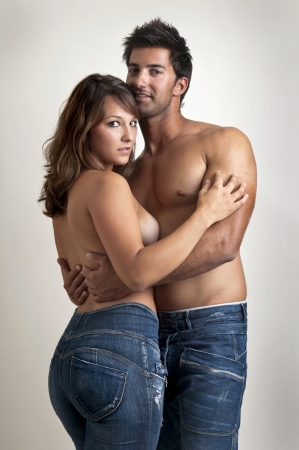Beautiful fashionable young couple dressed in jeans Stock Photo - 14718967