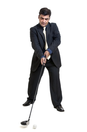Businessman with golf club and ball isolated photo
