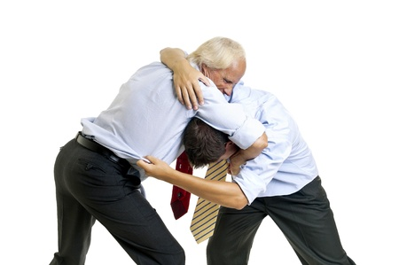 To businessmen wrestling isolated against a white background photo