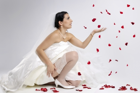 Beautiful bride posing isolated photo