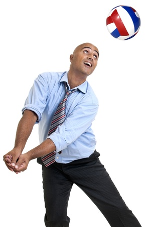 Businessman playing volleyball Stock Photo