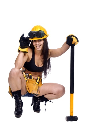 Sexy worker posing against a white background with hammer photo