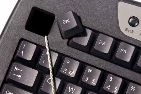 esc: Computer keyboard with a rope comming out of the Esc key.