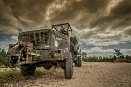 Old rusty truck with a dark moody sky photo