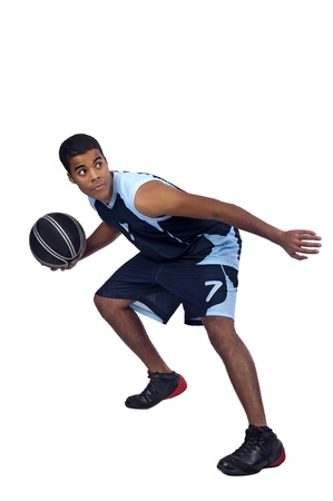 dribbling: Basketball player isolated in white