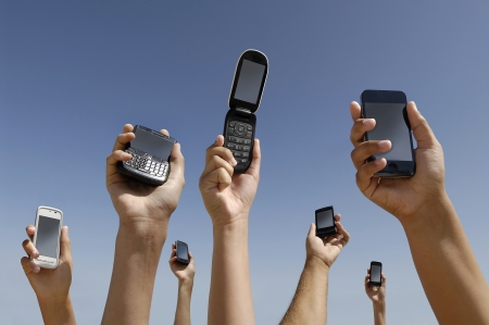 Group of hands with different cellphones connecting