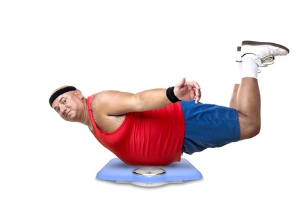 Large fitness man with a weight scale photo