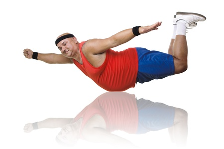 Large fitness man in a Superman pose