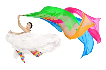Happy bride jumping with coloful stockings and scarfs photo