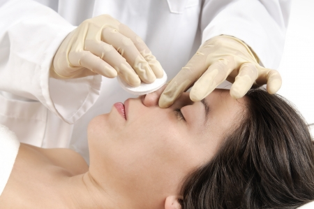 plastic glove: Woman preparing for cosmetic surgery