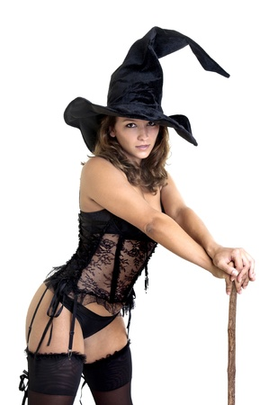 Sexy girl in witch costume isolated in white photo