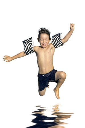 kids playing water: Young boy jumping in the water isolated in white