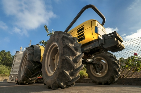 agriculture industry: Tractor in the field with a blue sky