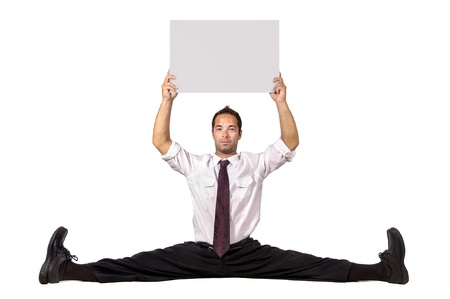 Businessman doing splits on the floor with a blank board photo