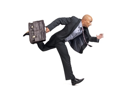Businessman or salesman with briefcase running isolated in white photo