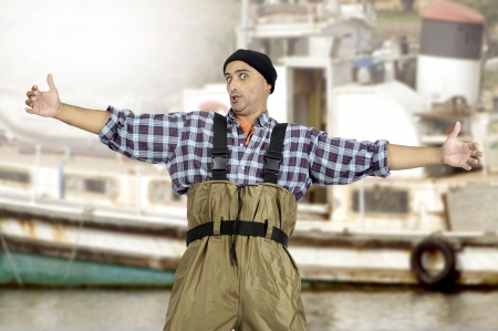 fishingpole: Exceeded fisherman with arms open wide Stock Photo