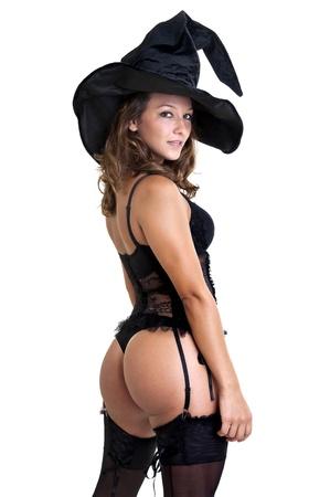 escoba: Chica sexy en traje de la bruja aislado en blanco Foto de archivo