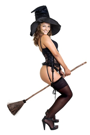sexy witch: Sexy girl in witch costume isolated in white