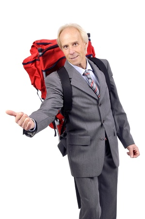 Mature businessman hitchhiking with backpack  photo