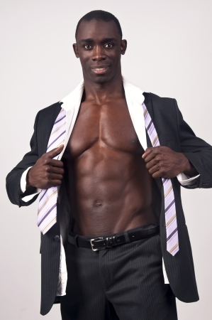 Young black man with muscular body and suit photo