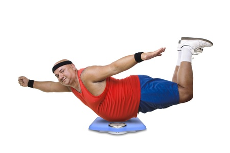 Large fitness man with a weight scale Stock Photo