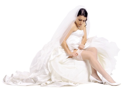Beautiful bride posing isolated in white photo