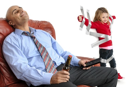Young girl glued to the wall with duct tape, so daddy can relax and have a beer