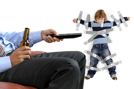 Young boy glued to the wall with duct tape, so daddy can relax and have a beer Stock Photo - 16671925