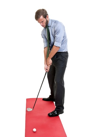 Businessman playing golf club isolated photo