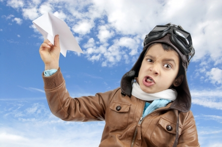 airman: Young boy pilot flying a paper plane