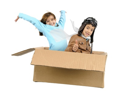 Youngcouple pilot flying a cardboard box isolated in white photo