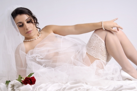 Beautiful bride posing in lingerie  photo