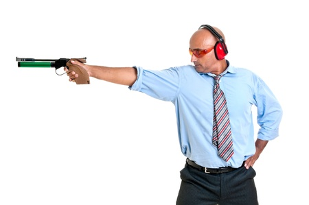 Businessman with compressed air gun shooting at a target photo