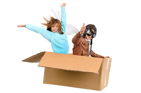 airman: Youngcouple pilot flying a cardboard box isolated in white