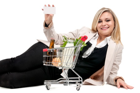 Woman with shopping cart and credit card isolated in white Stock Photo - 17050462