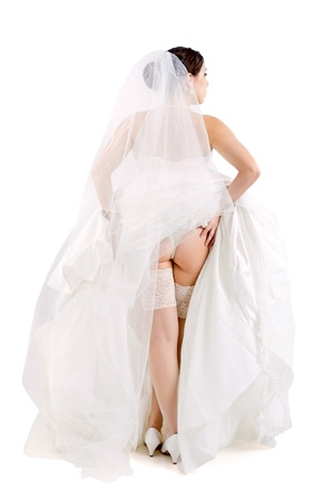Beautiful bride's back, showing stockings and lingerie photo