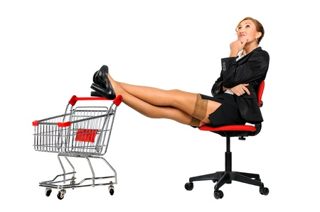 Woman in a chair with her feet resting in a shopping cart photo
