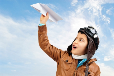 fighter pilot: Young boy pilot with a paper plane  Stock Photo