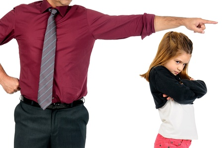 Young girl being grounded by her father photo