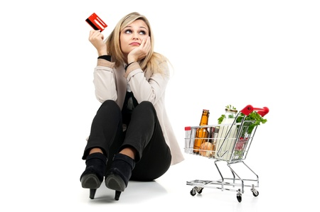 Woman with shopping cart and credit card isolated in white Stock Photo - 17417004