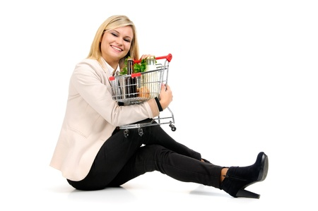 Woman with shopping cart isolated in white Stock Photo - 17417005